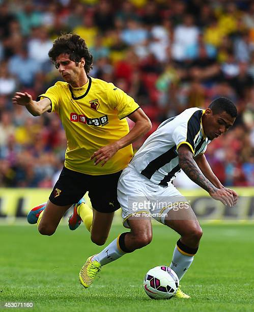 Diego Fabbrini of Watford and Allan Marques Loureiro of Udinese challenge for the ball during the preseason friendly between Watford and Udinese at...