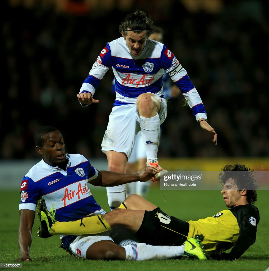 Diego Fabbrini of Watford is tackled by <a gi-track='captionPersonalityLinkClicked' href=/galleries/search?phrase=Joey+Barton&family=editorial&specificpeople=211284 ng-click='$event.stopPropagation()'>Joey Barton</a> and <a gi-track='captionPersonalityLinkClicked' href=/galleries/search?phrase=Nedum+Onuoha&family=editorial&specificpeople=2082844 ng-click='$event.stopPropagation()'>Nedum Onuoha</a> of QPR during the Sky Bet Championship match between Watford and Queens Park Rangers at Vicarage Road on December 29, 2013 in Watford, England,