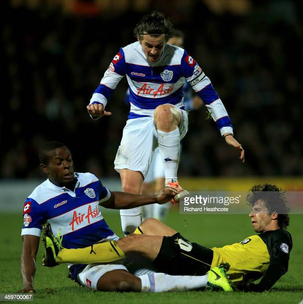 Diego Fabbrini of Watford is tackled by Joey Barton and Nedum Onuoha of QPR during the Sky Bet Championship match between Watford and Queens Park...