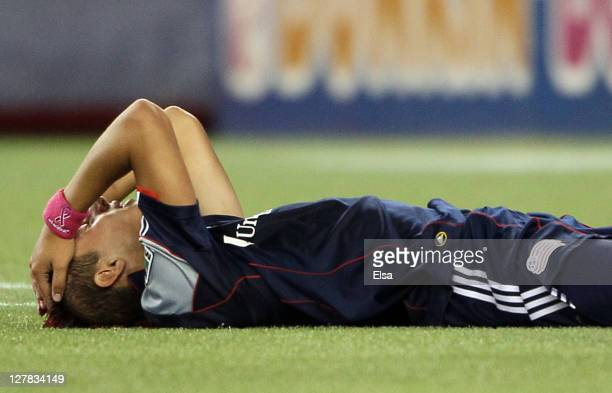 Diego Fagundez of the New England Revolution reacts after a missed shot and after he is hit in the head in the second half against the Seattle...