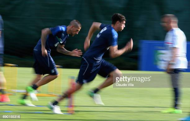 Diego Falcinelli and Alex Ferrari of Italy in action during the training session at Coverciano at Coverciano on May 30 2017 in Florence Italy