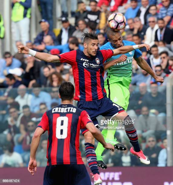 Diego Falcinelli of Crotone competes for the ball in air with Joao Miranda of Inter during the Serie A match between FC Crotone and FC Internazionale...