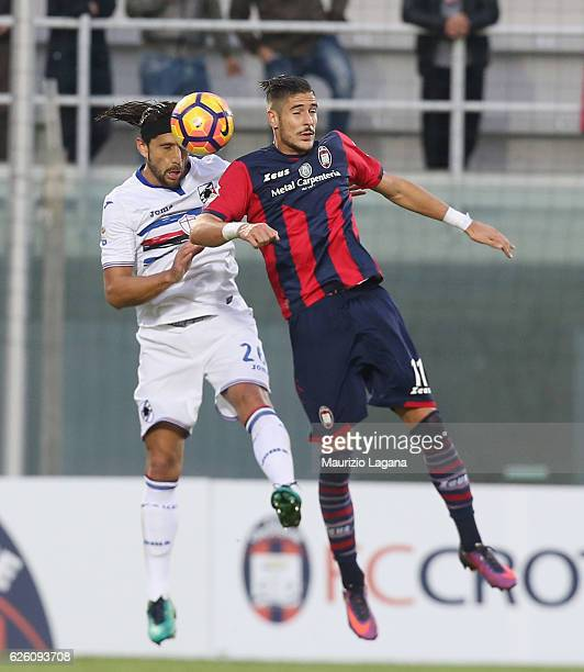 Diego Falcinelli of Crotone competes for the ball in air with Matias Silvestre of Sampdoria during the Serie A match between FC Crotone and UC...