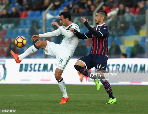 Diego Falcinelli of Crotone competes for the ball with Alberto Aquilani of Sassuolo during the Serie A match between FC Crotone and US Sassuolo at...
