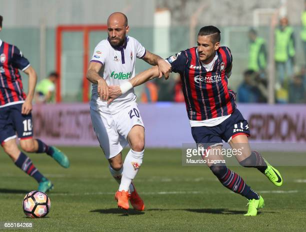 Diego Falcinelli of Crotone competes for the ball with Borja Valero of Fiorentina during the Serie A match between FC Crotone and ACF Fiorentina at...