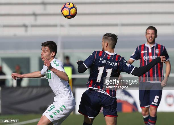 Diego Falcinelli of Crotone competes for the ball with Cristian Dell'Orco of Sassuolo during the Serie A match between FC Crotone and US Sassuolo at...