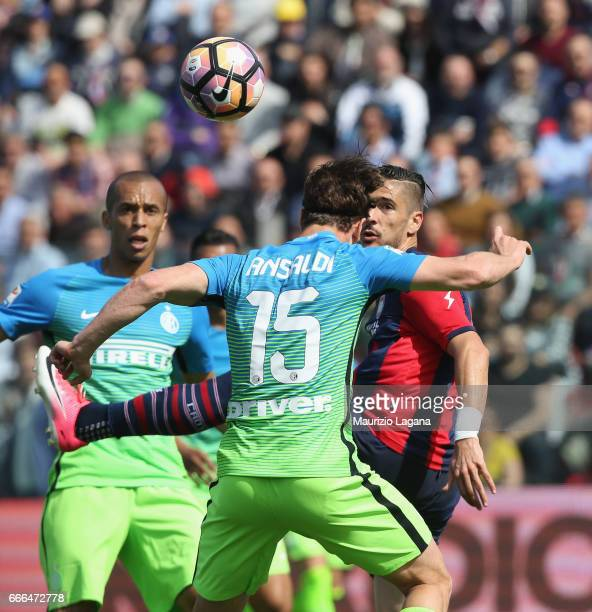 Diego Falcinelli of Crotone competes for the ball with Cristian Ansaldi of Inter during the Serie A match between FC Crotone and FC Internazionale at...