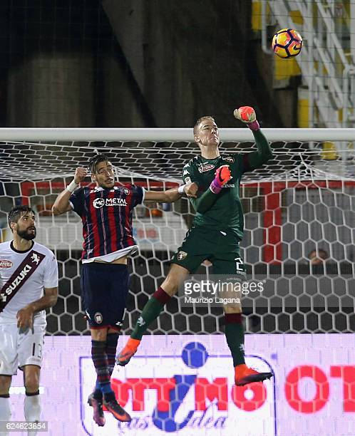 Diego Falcinelli of Crotone competes for the ball with Joe Hart of Torino during the Serie A match between FC Crotone and FC Torino at Stadio...