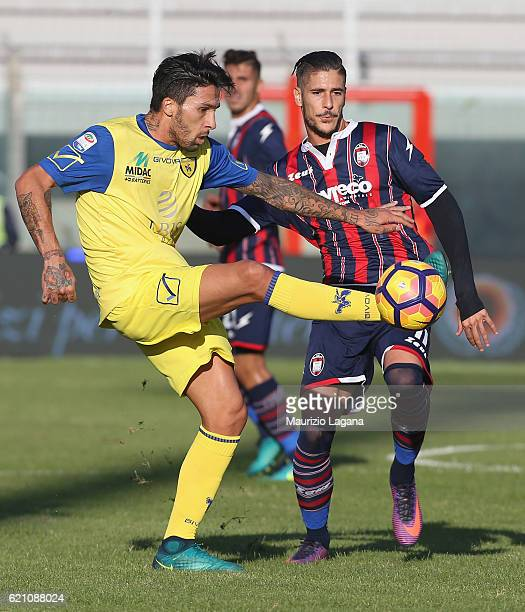 Diego Falcinelli of Crotone competes for the ball with Lucas Castro of Chievo during the Serie A match between FC Crotone and AC ChievoVerona at...