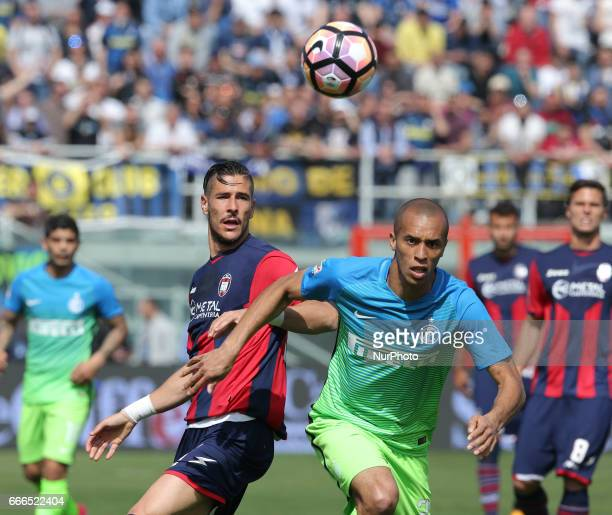 Diego Falcinelli of Crotone competes for the ball with Miranda of Inter during the Serie A match between FC Crotone and FC Internazionale at Stadio...