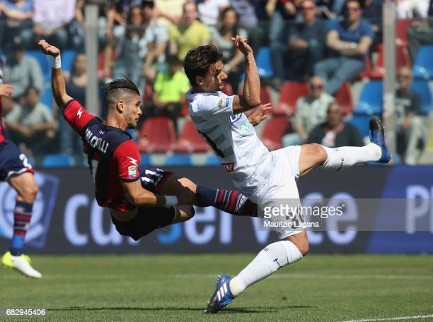 Diego Falcinelli of Crotone competes with Felipe of Udinese during the Serie A match between FC Crotone and Udinese Calcio at Stadio Comunale Ezio...