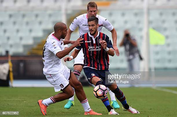Diego Falcinelli of Crotone is challenged by Haitam Aleesami and Slobodan Rajkovic of Palermo during the Serie A match between FC Crotone and US...