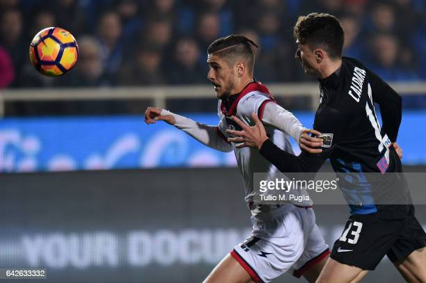 Diego Falcinelli of Crotone is challenged by Mattia Caldara of Atalanta during the Serie A match between Atalanta BC and FC Crotone at Stadio Atleti...