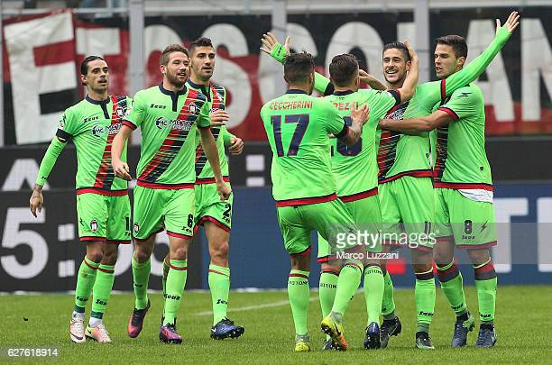 Diego Falcinelli of FC Crotone celebrates with his teammates after scoring the opening goal during the Serie A match between AC Milan and FC Crotone...