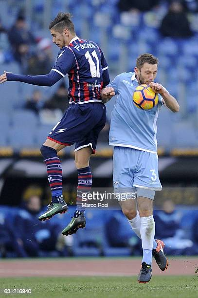 Diego Falcinelli of FC Crotone compete for the ball with Stefan De Vrij of SS Lazio during the Serie A match between SS Lazio and FC Crotone at...