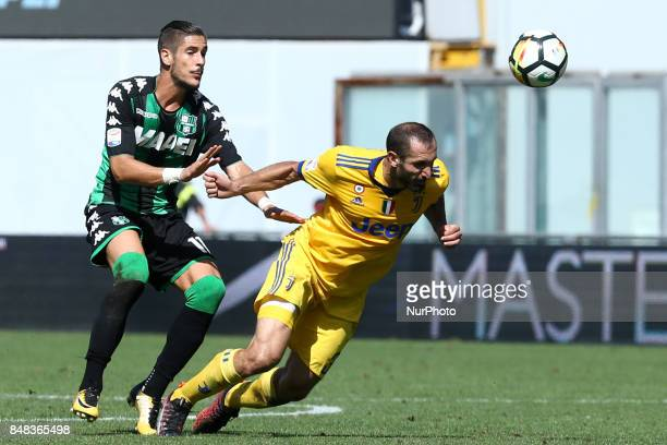 Diego Falcinelli of Sassuolo and Giorgio Chiellini of Juventus during the Serie A match between US Sassuolo and Juventus at Mapei Stadium Citta' del...