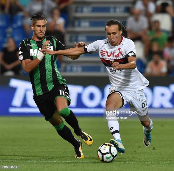 Diego Falcinelli of US Sassuolo and Adel Taarabt of Genoa CFC in action during the Serie A match between US Sassuolo and Genoa CFC at Mapei Stadium...