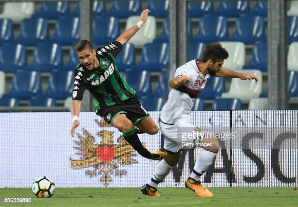 Diego Falcinelli of US Sassuolo competes for the ball whit Pinto Veloso Miguel of Genoa CFC during the Serie A match between US Sassuolo and Genoa...