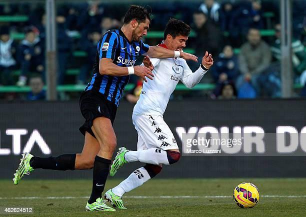 Diego Farias Da Silva of Cagliari Calcio is challenged by Guglielmo Stendardo of Atalanta BC during the Serie A match between Atalanta BC and...