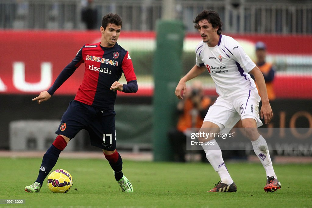 Diego Farias of Cagliari and Stefan Savic of Fiorentina compete for the ball during the Serie A match between Cagliari Calcio and ACF Fiorentina at...