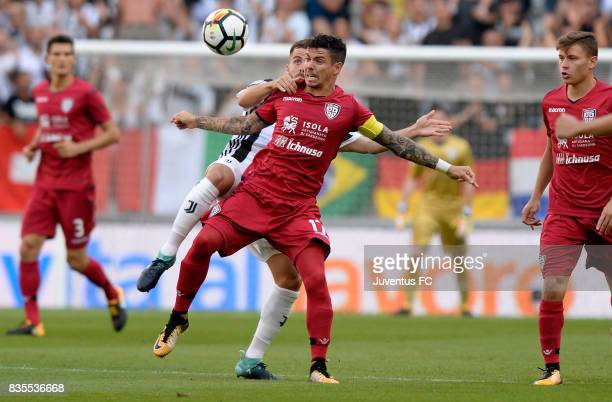 Diego Farias of Cagliari battles for the ball with Miralem Pjanic of Juventus during the Serie A match between Juventus and Cagliari Calcio at...