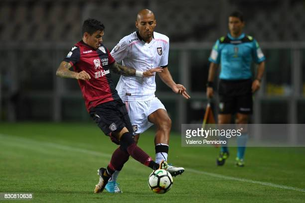 Diego Farias of Cagliari Calcio is challenged by Haitam Aleesami of US Citta di Palermo during the TIM Cup match between Cagliari Calcio and US Citta...