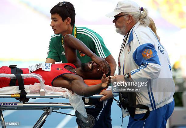 Diego Ferrin of Ecuador is taken off on a stretcher after an injury during the in the Men's High Jump qualification during Day Four of the 14th IAAF...