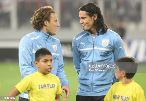 Diego Forlan and Edison Cavani of Uruguay before a match between Peru and Uruguay as part of the 15th round of the South American Qualifiers at...
