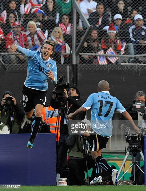 Diego Forlan from Uruguay celebrates the second goal of his team against Paraguay during 2011 Copa America soccer final match at Monumental stadium...