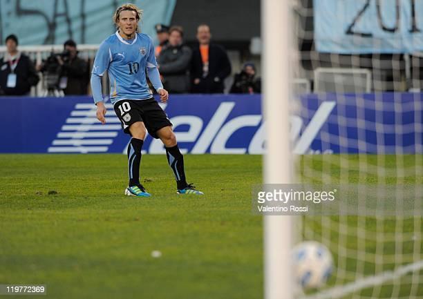 Diego Forlan from Uruguay kicks the ball to score against Paraguay during 2011 Copa America soccer final match at Antonio Vespucio Liberti stadium on...
