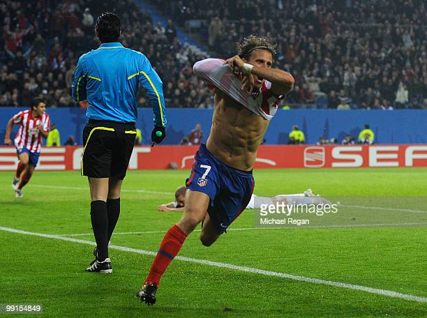 Diego Forlan of Atletico Madrid celebrates after scoring his team's second and winning goal in extra time during the UEFA Europa League final match...