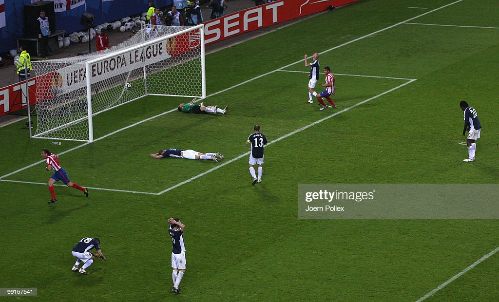Diego Forlan of Atletico Madrid celebrates after scoring his team's second and winning goal against goalkeeper Mark Schwarzer of Fulham during the UEFA Europa League final match between Atletico Madrid and Fulham at HSH Nordbank Arena on May 11, 2010 in Hamburg, Germany.