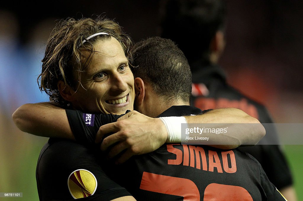 Diego Forlan of Atletico Madrid celebrates with his team mate Simao at the end of the UEFA Europa League Semi-Final Second Leg match between Liverpool and Atletico Madrid at Anfield on April 29, 2010 in Liverpool, England.