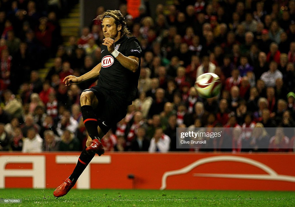 Diego Forlan of Atletico Madrid scores his team's first goal in extra time during the UEFA Europa League Semi-Final Second Leg match between Liverpool and Atletico Madrid at Anfield on April 29, 2010 in Liverpool, England.