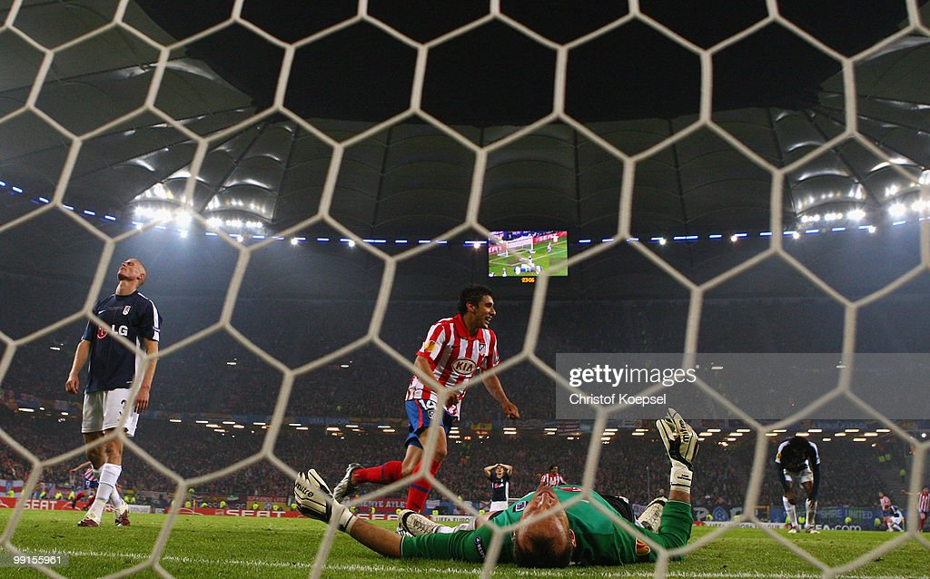Diego Forlan of Atletico Madrid scores his team's second and winning goal against goalkeeper Mark Schwarzer of Fulham during the UEFA Europa League final match between Atletico Madrid and Fulham at HSH Nordbank Arena on May 11, 2010 in Hamburg, Germany.