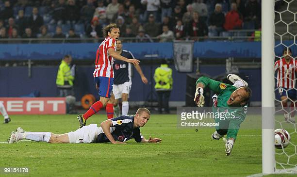 Diego Forlan of Atletico Madrid scores his team's second goal against goalkeeper Mark Schwarzer of Fulham during the UEFA Europa League final match...