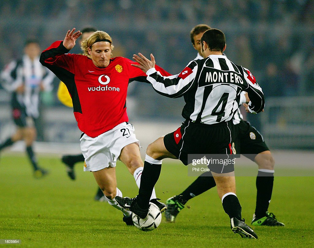Diego Forlan of Manchester United and Paolo Montero of Juventus