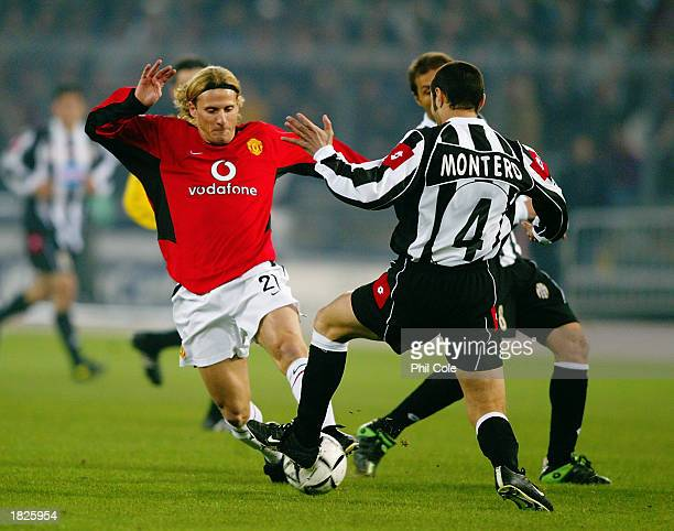 Diego Forlan of Manchester United is tackled by Paolo Montero of Juventus during the UEFA Champions League Second Phase Group D match held on...