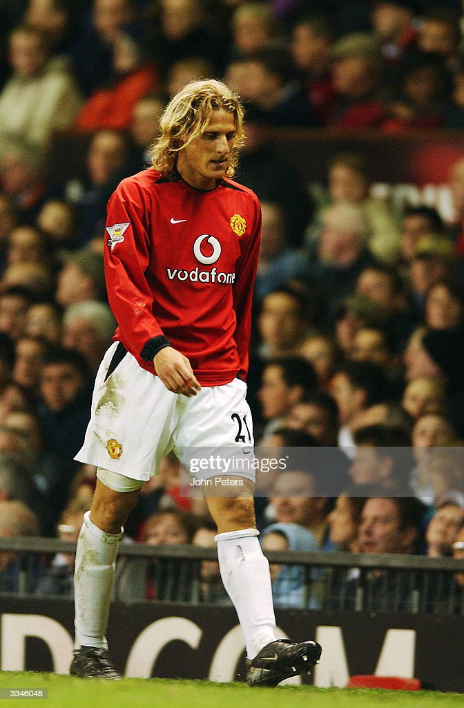 Diego Forlan of Manchester United looks disappointed as he is substituted during the FA Barclaycard Premiership match between Manchester United and Leicester City at Old Trafford on April 13, 2004 in Manchester, England.
