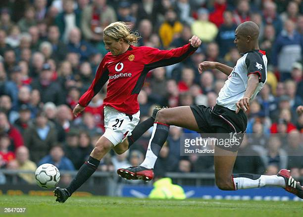 Diego Forlan of United gets past Zat Knight of Fulham to score during the FA Barclaycard Premiership match between Manchester United and Fulham at...