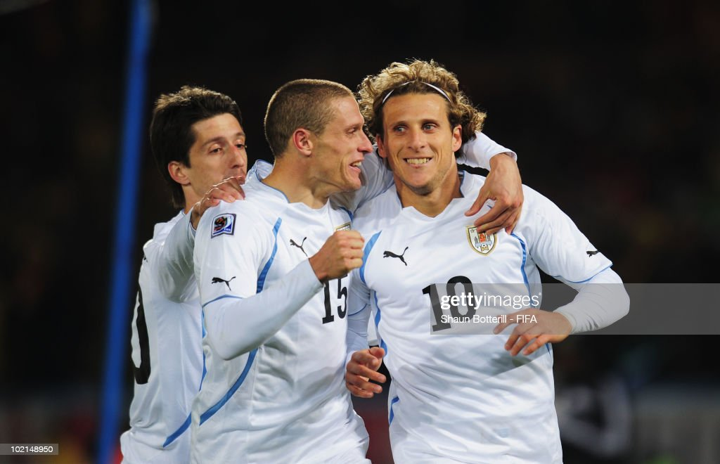 <a gi-track='captionPersonalityLinkClicked' href=/galleries/search?phrase=Diego+Forlan&family=editorial&specificpeople=171096 ng-click='$event.stopPropagation()'>Diego Forlan</a> (R) of Uruguay celebrates after scoring the second goal from the penalty spot with team mates <a gi-track='captionPersonalityLinkClicked' href=/galleries/search?phrase=Alvaro+Fernandez&family=editorial&specificpeople=2946918 ng-click='$event.stopPropagation()'>Alvaro Fernandez</a> (L) and <a gi-track='captionPersonalityLinkClicked' href=/galleries/search?phrase=Diego+Perez&family=editorial&specificpeople=697338 ng-click='$event.stopPropagation()'>Diego Perez</a> (C) during the 2010 FIFA World Cup South Africa Group A match between South Africa and Uruguay at Loftus Versfeld Stadium on June 16, 2010 in Tshwane/Pretoria, South Africa.