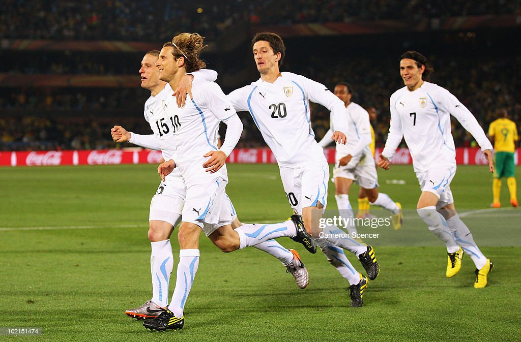 <a gi-track='captionPersonalityLinkClicked' href=/galleries/search?phrase=Diego+Forlan&family=editorial&specificpeople=171096 ng-click='$event.stopPropagation()'>Diego Forlan</a> of Uruguay celebrates after scoring the second goal from the penalty spot with team mates <a gi-track='captionPersonalityLinkClicked' href=/galleries/search?phrase=Alvaro+Fernandez&family=editorial&specificpeople=2946918 ng-click='$event.stopPropagation()'>Alvaro Fernandez</a> and <a gi-track='captionPersonalityLinkClicked' href=/galleries/search?phrase=Diego+Perez&family=editorial&specificpeople=697338 ng-click='$event.stopPropagation()'>Diego Perez</a> during the 2010 FIFA World Cup South Africa Group A match between South Africa and Uruguay at Loftus Versfeld Stadium on June 16, 2010 in Tshwane/Pretoria, South Africa.