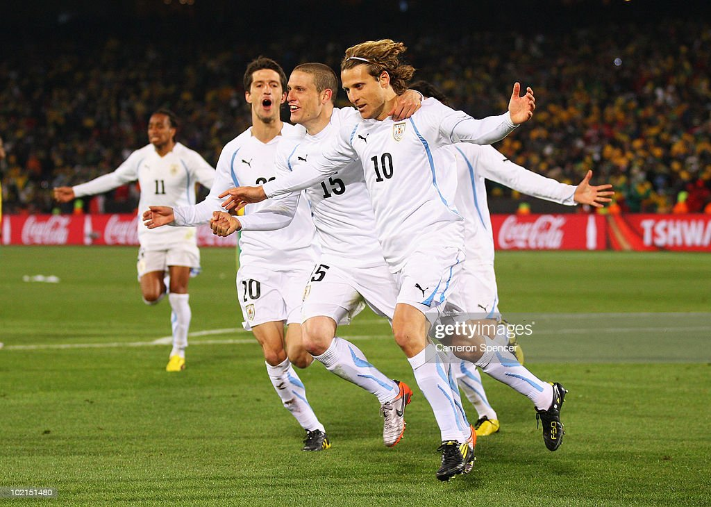 <a gi-track='captionPersonalityLinkClicked' href=/galleries/search?phrase=Diego+Forlan&family=editorial&specificpeople=171096 ng-click='$event.stopPropagation()'>Diego Forlan</a> (R) of Uruguay celebrates after scoring the second goal from the penalty spot with team mates <a gi-track='captionPersonalityLinkClicked' href=/galleries/search?phrase=Alvaro+Fernandez&family=editorial&specificpeople=2946918 ng-click='$event.stopPropagation()'>Alvaro Fernandez</a> (L) and <a gi-track='captionPersonalityLinkClicked' href=/galleries/search?phrase=Diego+Perez&family=editorial&specificpeople=697338 ng-click='$event.stopPropagation()'>Diego Perez</a> during the 2010 FIFA World Cup South Africa Group A match between South Africa and Uruguay at Loftus Versfeld Stadium on June 16, 2010 in Tshwane/Pretoria, South Africa.