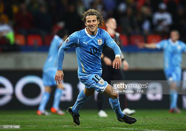 Diego Forlan of Uruguay celebrates scoring his side's second goal during the 2010 FIFA World Cup South Africa Third Place Playoff match between...