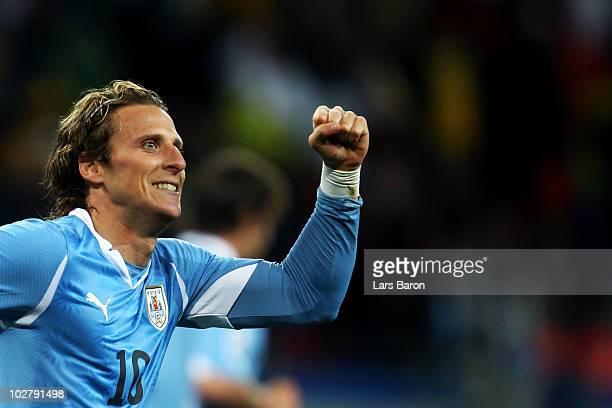 Diego Forlan of Uruguay celebrates scoring his team's second goal during the 2010 FIFA World Cup South Africa Third Place Playoff match between...