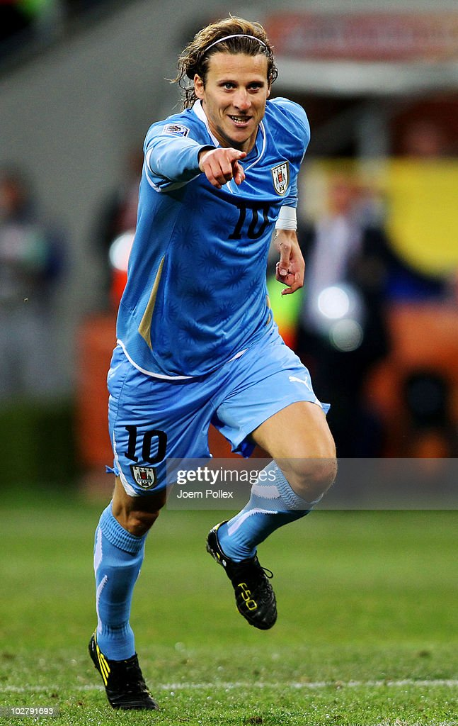 <a gi-track='captionPersonalityLinkClicked' href=/galleries/search?phrase=Diego+Forlan&family=editorial&specificpeople=171096 ng-click='$event.stopPropagation()'>Diego Forlan</a> of Uruguay celebrates scoring his team's second goal during the 2010 FIFA World Cup South Africa Third Place Play-off match between Uruguay and Germany at The Nelson Mandela Bay Stadium on July 10, 2010 in Port Elizabeth, South Africa.