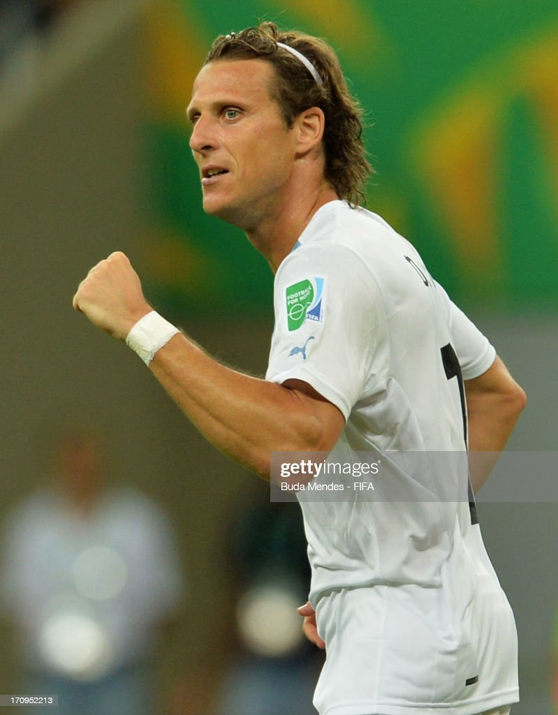 <a gi-track='captionPersonalityLinkClicked' href=/galleries/search?phrase=Diego+Forlan&family=editorial&specificpeople=171096 ng-click='$event.stopPropagation()'>Diego Forlan</a> of Uruguay celebrates scoring his team's second goal during the FIFA Confederations Cup Brazil 2013 Group B match between Nigeria and Uruguay at Estadio Octavio Mangabeira (Arena Fonte Nova Salvador) on June 20, 2013 in Salvador, Brazil.
