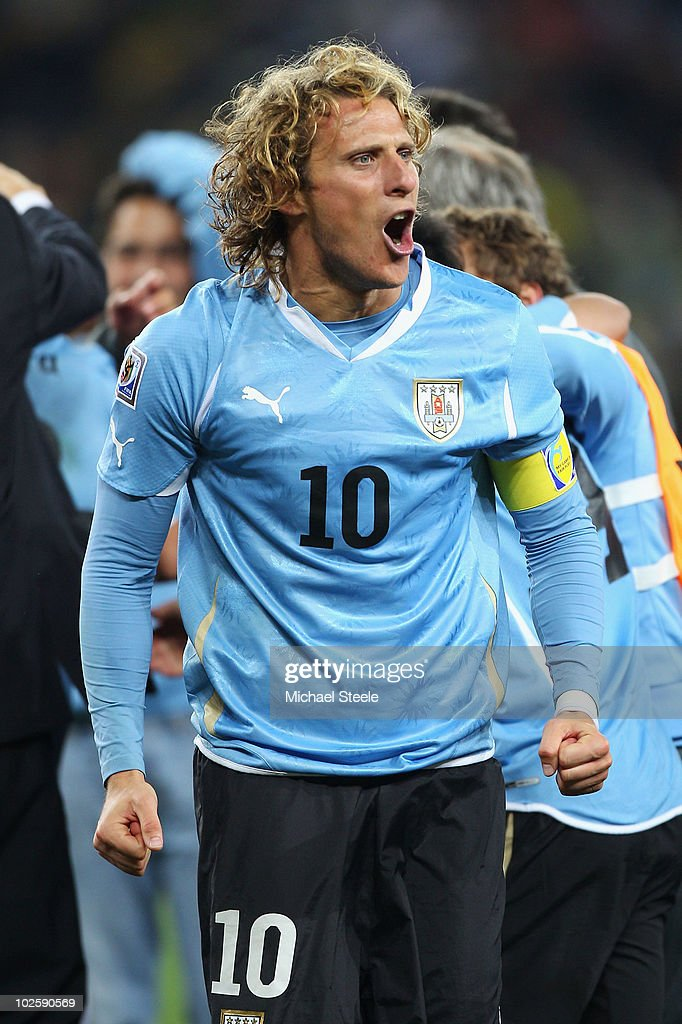 <a gi-track='captionPersonalityLinkClicked' href=/galleries/search?phrase=Diego+Forlan&family=editorial&specificpeople=171096 ng-click='$event.stopPropagation()'>Diego Forlan</a> of Uruguay celebrates victory after winning a penalty shoot out during the 2010 FIFA World Cup South Africa Quarter Final match between Uruguay and Ghana at the Soccer City stadium on July 2, 2010 in Johannesburg, South Africa.