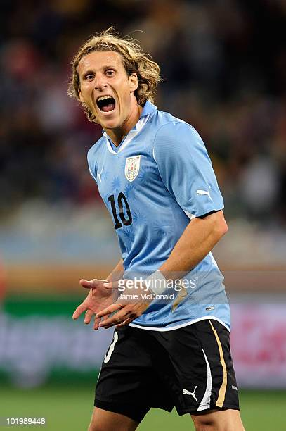 Diego Forlan of Uruguay gestures during the 2010 FIFA World Cup South Africa Group A match between Uruguay and France at Green Point Stadium on June...