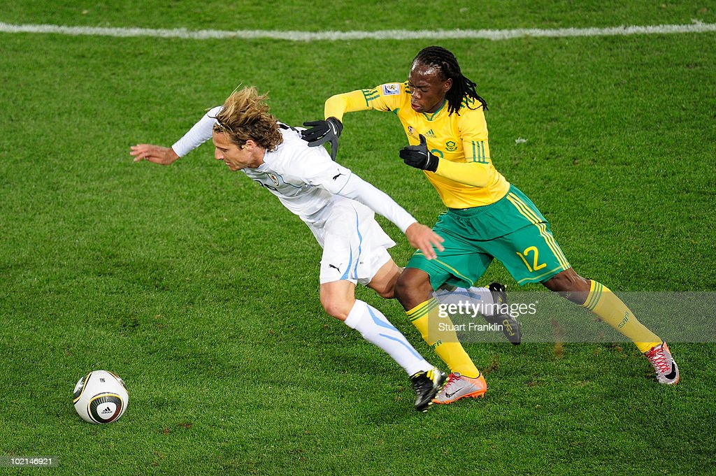 <a gi-track='captionPersonalityLinkClicked' href=/galleries/search?phrase=Diego+Forlan&family=editorial&specificpeople=171096 ng-click='$event.stopPropagation()'>Diego Forlan</a> of Uruguay is closed down by <a gi-track='captionPersonalityLinkClicked' href=/galleries/search?phrase=Reneilwe+Letsholonyane&family=editorial&specificpeople=5458900 ng-click='$event.stopPropagation()'>Reneilwe Letsholonyane</a> of South Africa during the 2010 FIFA World Cup South Africa Group A match between South Africa and Uruguay at Loftus Versfeld Stadium on June 16, 2010 in Tshwane/Pretoria, South Africa.